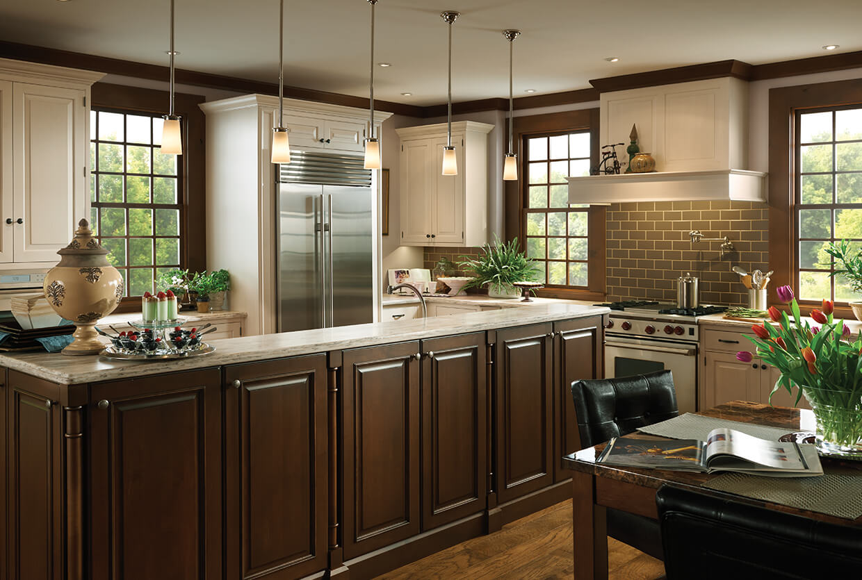 Kinetic Kitchen and Bath rustic kitchen design in dark mahogany.