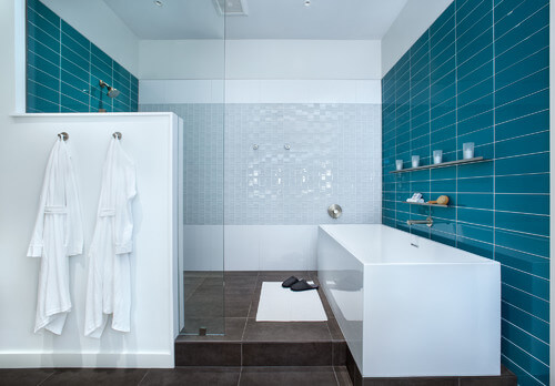 The stacked tiles are a fun way to bring in a bold color by using a simple pattern. I love the balance in this space.