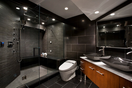This contemporary style bathroom boasts of a gorgeous, sleek design. Lighting plays a big role in this design which allows the space to not feel overwhelming or closed in. I love the vessel sinks.