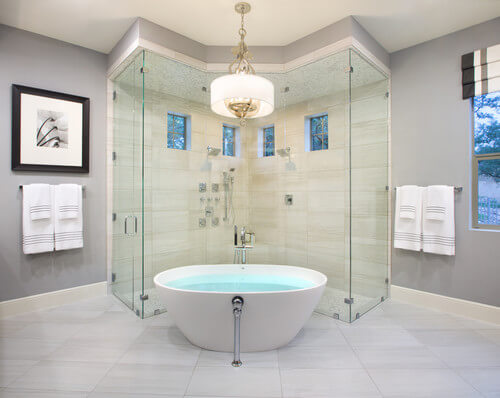 The shape of the shower adds a unique touch that is different than your traditional bathroom layout. I love how the shower hugs the bathtub.