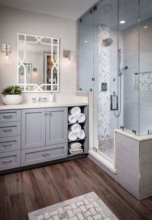 Grey is currently a big color in the design world. The herringbone tile pulls in each shade of grey throughout the bathroom.