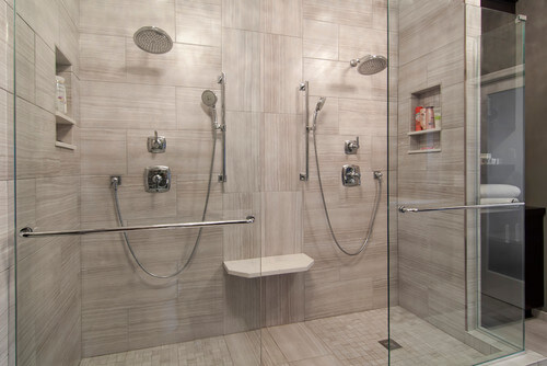 Two is better than one. This design takes advantage of a large shower space and gives each person their own controls, storage and screens.