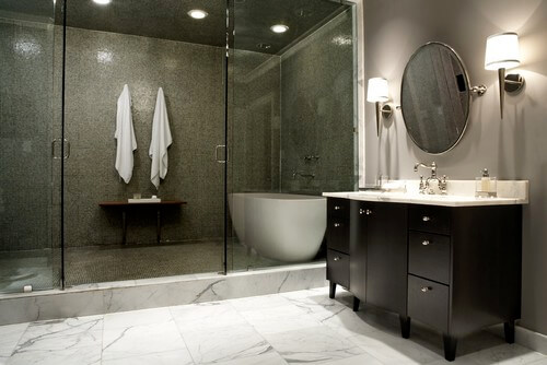 A tub and a shower CAN be in the same area! Maybe you desire a large shower and a free standing tub but don't think that you have the space for it. This design allows for you to have both. Such a beautiful design element!