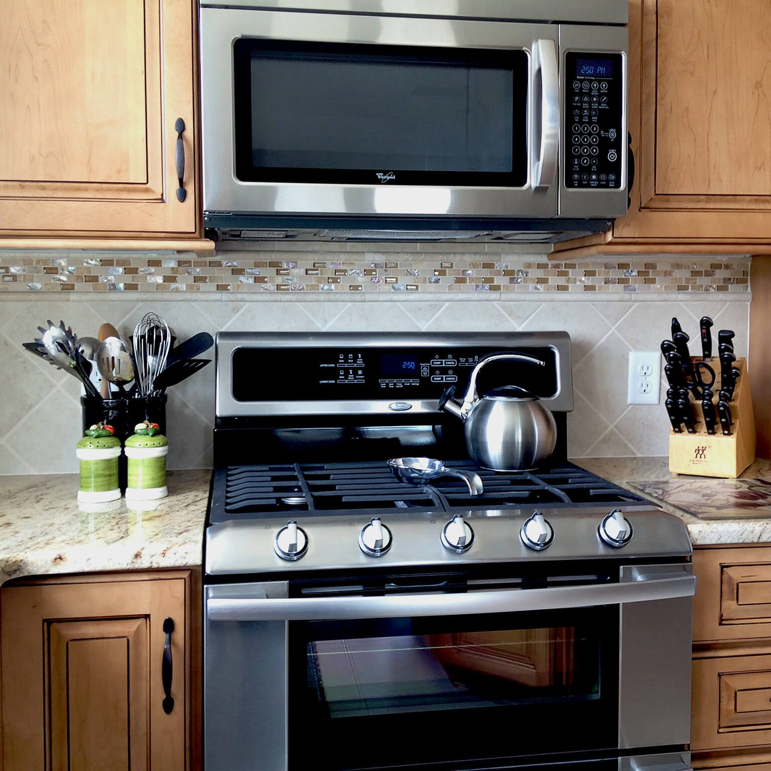 Kinetic Kitchen and Bath Gallery Photo - Kitchen remodel design photo of stove, counters and cabinets